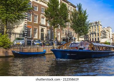 Amsterdam, Netherlands, on July 10, 2014. Walk boat is moving at the channel