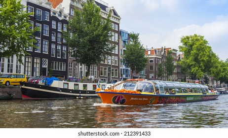 Amsterdam, Netherlands, on July 10, 2014. A typical urban view with old buildings on the bank of the channel
