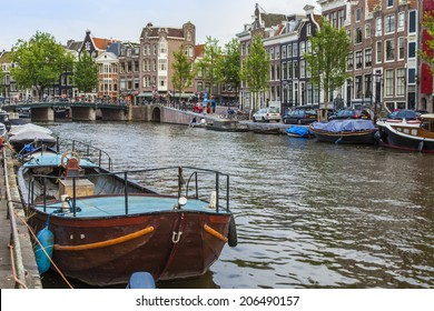 Amsterdam, Netherlands, on July 7, 2014. Typical urban view. Old houses on the bank of the channel
