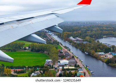AMSTERDAM, NETHERLANDS, on OCTOBER 23, 2018. A view of suburbs of Amsterdam from a window of the plane coming in the land at the international airport Schiphol