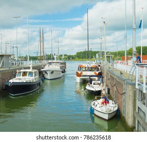 AMSTERDAM, THE NETHERLANDS - SEP 11, 2016: Boats and yachts enter the Oranje locks on the city's IJ river. The locks are built in 1872.