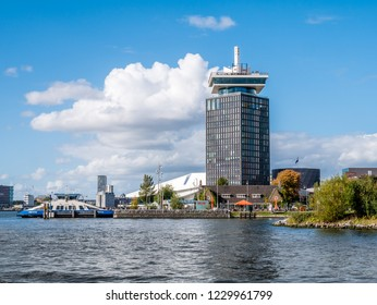 AMSTERDAM, NETHERLANDS - SEP 28, 2018: Adam Tower, Eye Filmmuseum and ferry from River IJ in Amsterdam, Netherlands