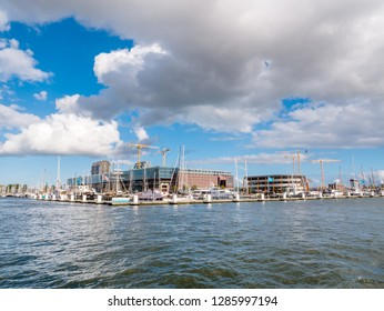 AMSTERDAM, NETHERLANDS - SEP 28, 2018: Amsterdam marina and NDSM wharf on northern bank of IJ river in Amsterdam, Netherlands