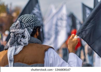 Amsterdam, Netherlands, Sept 16th 2012: Anti Islam Protest: Muslim holding flag