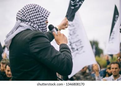 Amsterdam, Netherlands, Sept 16th 2012: Anti Islam Protest - Muslim Man speaking in mircophone