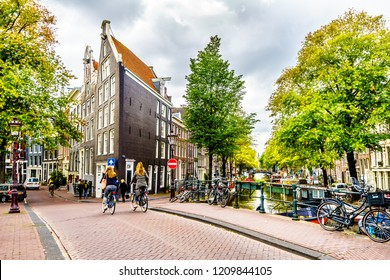 Amsterdam, the Netherlands - Sept 28, 2018: Historic Houses at the Bridge intersection of the Bloemgracht and Prinsengracht canals in the Jordaan neighborhood and across from the Anne Frank House