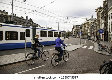 Amsterdam, Netherlands - September 05 2016: Trams in traffic on a street of the city, summer time, toruism in Europe
