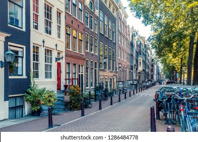 AMSTERDAM, NETHERLANDS, - SEPTEMBER 1, 2019:  Street scene from the city of Amsterdam with example of typical architecture.