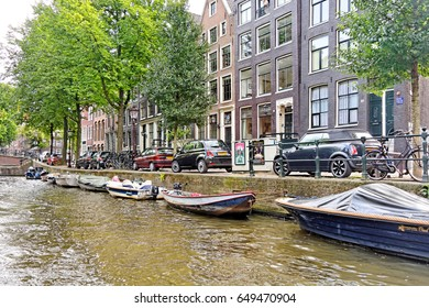 Amsterdam, Netherlands, September 11, 2016: Landscape and culture along canal in Amsterdam
