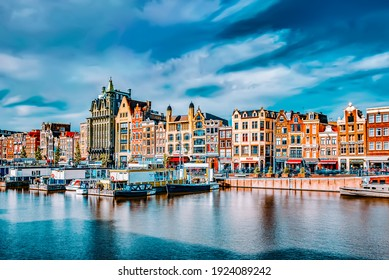 """AMSTERDAM, NETHERLANDS - SEPTEMBER 15, 2015: Beautiful views of the streets, ancient buildings, people, embankments of Amsterdam - also call """"Venice in the North"""". Netherland"""
