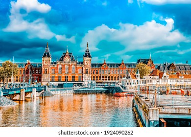 AMSTERDAM, NETHERLANDS - SEPTEMBER 15, 2015: Beautiful buildings Amsterdam Central station.(Station Amsterdam Centraal). Amsterdam Centraal was designed by Pierre Cuypers, who is also known for his de