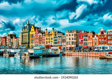 """AMSTERDAM, NETHERLANDS - SEPTEMBER 15, 2015: Beautiful views of the streets, ancient buildings, people in Amsterdam - also call """"Venice in the North"""""""