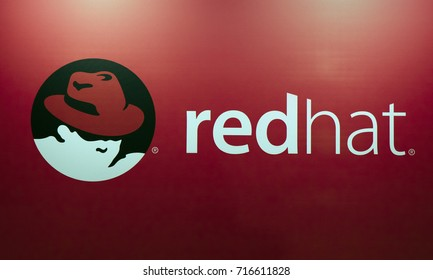 Amsterdam, Netherlands -september 15, 2017: redhat logo and letters on a red wall