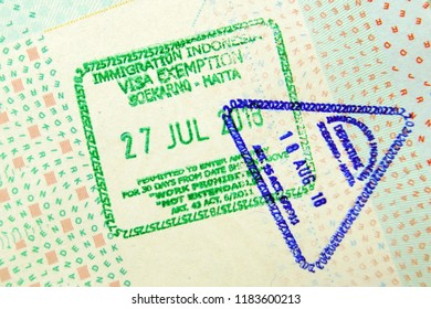Amsterdam, the Netherlands - September 15, 2018: Passport immigration visa stamps entering en exiting Indonesia. The stamps are not traceable to a person.