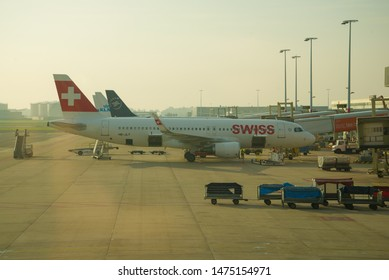 AMSTERDAM, NETHERLANDS - SEPTEMBER 17, 2017: Airbus A320-200 (HB-JLT) Swiss International Air Lines  on Schiphol Airport peron on a sunny September morning
