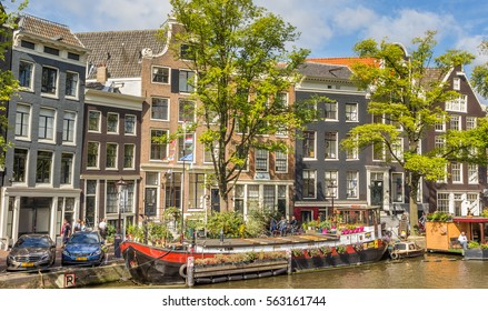 AMSTERDAM, NETHERLANDS - SEPTEMBER 18, 2016: Colorful boat with flowers in the center of Amsterdam, Holland