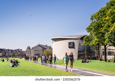 AMSTERDAM, NETHERLANDS - SEPTEMBER 2, 2018:  View of Van Gogh Museum seen from outdoors with people.
