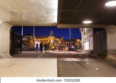 Amsterdam, Netherlands - September 22 2017: People are walking through the tunnel of Central Railroad Station in evening