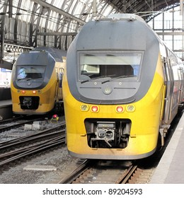 AMSTERDAM, NETHERLANDS - SEPTEMBER 22: Passenger Trains NS Intercity on September 22, 2011 in Amsterdam Central Station. Nederlandse Spoorwegen is the largest rail transport operator in NL.