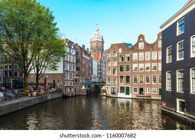 AMSTERDAM, NETHERLANDS - SEPTEMBER 25, 2017: Amsterdam City Center. Beautiful view of Amsterdam Canals with Bridge and typical Dutch Houses. Amsterdam, Netherlands.