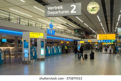 Amsterdam, The Netherlands - September 27, 2015: Check-in counters and Departures hall in Amsterdam Schiphol Airport (North Holland, The Netherlands).