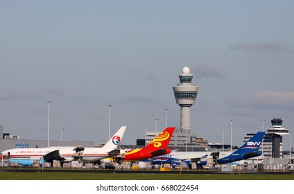 AMSTERDAM, THE NETHERLANDS - SEPTEMBER 30, 2015:  Parked freight planes on Schiphol cargo, including a Boeing 777 and 747on September 30 , 2015 in Amsterdam, the netherlands.