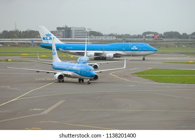 AMSTERDAM, NETHERLANDS - SEPTEMBER 30, 2017: A cloudy day on the airfield of Schiphol airport
