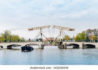 Amsterdam, Netherlands September 5, 2017: Magere Brug Bridge and Amstel river.