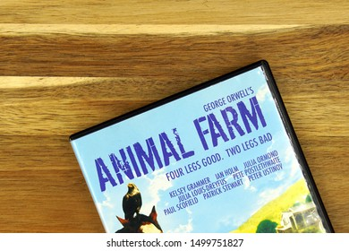 Amsterdam, the Netherlands - September 7, 2019: Part of a DVD movie cover from George Orwell's animal farm against a wooden background.