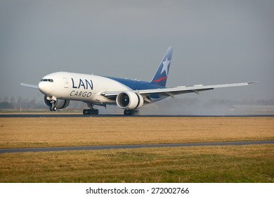 AMSTERDAM, THE NETHERLANDS--17 MAY 2014-- A LAN Boeing 777 cargo airplane has just landed on the runway.