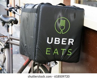 Amsterdam, Netherlands-april 9, 2017: Uber eats bicycle in a street of amsterdam