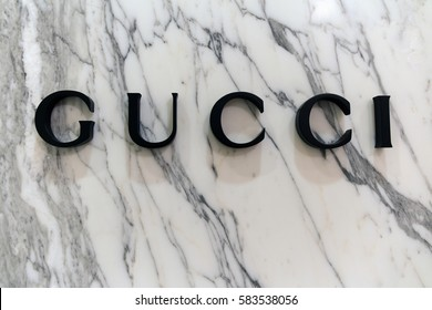 Amsterdam, Netherlands-february 19, 2017: Letters Gucci on a marble wall