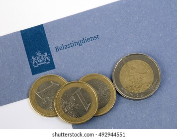 Amsterdam, Netherlands-march 11, 2016: blue enveloppe of the dutch tax department with euro coins Illustrative Editorial