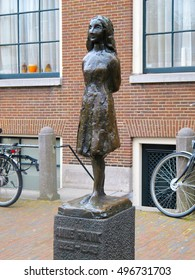 AMSTERDAM, NETHERLANDS-MARCH 13, 2011: Anne Frank statue in front of Anne Frank Museum in Amsterdam. A victim of Nazi Germany in World War 2 she wrote a diary of her short life before she was killed.