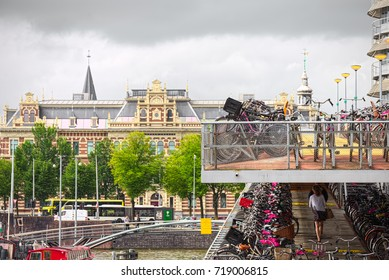 Amsterdam, NL, Aug 13, 2016 - Rain clouds on the terrace of the bicycle storage