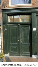 Amsterdam, NL, Netherlands - August 23, 2017: Entrance door of the house of Anne Frank a Jewish child living in Holland during World War II