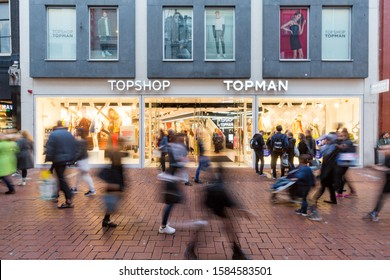 Amsterdam, Noord Holland / The Netherlands, 29-11-2016 Busy shopping street in front of the TopShop TopMan store Kalverstraat Amsterdam