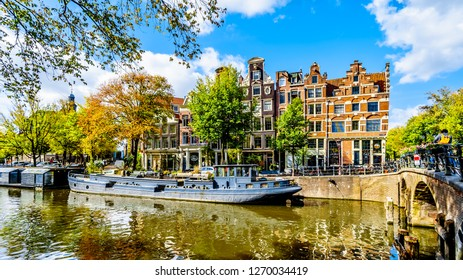 Amsterdam, Noord Holland/the Netherlands - Oct. 3 2018: The Prinsengracht (Prince Canal) at the Lekkersluis Bridge with its many historic houses and House Boats in the center of Amsterdam