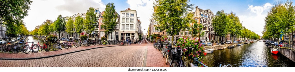 Amsterdam, Noord Holland/the Netherlands - Oct. 3 2018: Panorama view of the Herengracht canal viewed from the bridge at the Blauwburgwal in the center of Amsterdam