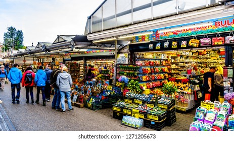 Amsterdam, Noord Holland/the Netherlands - Oct. 3 2018: Souvenir shops at the famous Bloemenmarkt (Flower Market) along the Singel Canal in the center of Amsterdam