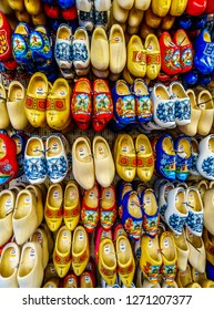 Amsterdam, Noord Holland/the Netherlands - Oct. 3 2018: Colorful Wooden Shoes at a souvenir shop the famous Bloemenmarkt (Flower Market) along the Singel Canal in the center of Amsterdam