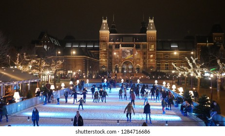 Amsterdam, North Holland - December 28 2018: An ice rink in Amsterdam at the Museumplein in winter at Christmas time