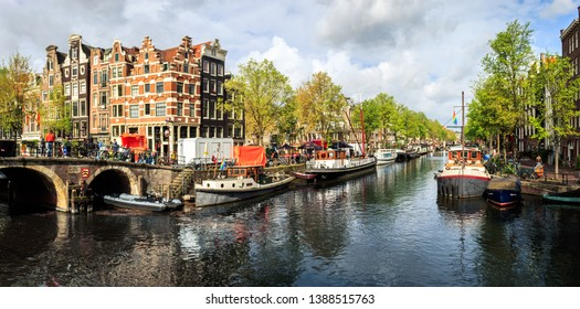 Amsterdam, North Holland / Netherlands - April 27, 2019: A beautiful panorama view of the canals and historic old houses on King's Day in the Dutch capital of Amsterdam.
