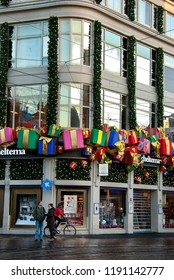 Amsterdam, North Holland, The Netherlands - December 2014: Streets of Amsterdam with colorful christmas decoration, gift boxes