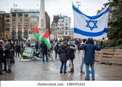 Amsterdam, North Holland / Netherlands - December 15, 2019: A supporter of Israel faces off against pro-Palestinian BDS protesters in the Dam Square.