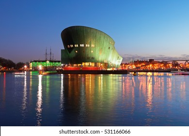 AMSTERDAM, NORTH HOLLAND/ THE NETHERLANDS - DECEMBER 3,2016: NEMO Science Museum illuminated in the evening during  Amsterdam Light Festival
