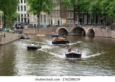 Amsterdam, North Holland / Netherlands - June 21, 2020: Pleasure boating on the canals of Amsterdam on a Sunday afternoon.