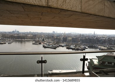 AMSTERDAM, NORTH HOLLAND / NETHERLANDS - MARCH 21 2010: View of Amsterdam harbor Oosterdok and Amsterdam from the observation floor of OBA central library in Amsterdam.