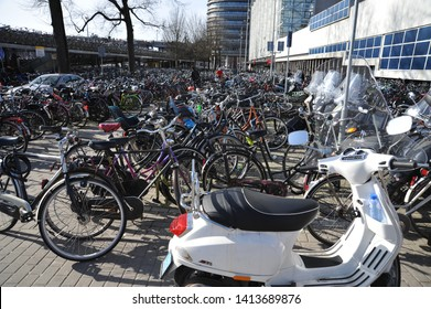 AMSTERDAM, NORTH HOLLAND / NETHERLANDS - MARCH 21 2010:  A thousand bicycles are parked in a bicycle parking lot on Stationsplein in central Amsterdam.