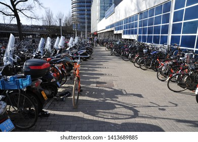 AMSTERDAM, NORTH HOLLAND / NETHERLANDS - MARCH 21 2010:  A thousand bicycles are parked in a bicycle parking lot in downtown Amsterdam.